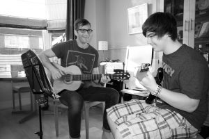 Richard and Alaister enjoying their guitar lesson in felpham